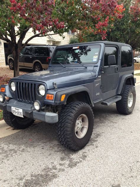 make jeep model wrangler year 2002 exterior color blue interior color charcoal doors two