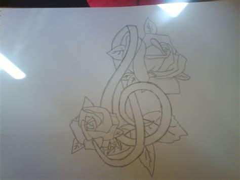 tattoo design music symbol music symbol and roses tattoo by plaistowkidd on deviantart