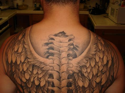 spine tattoos for guys wings tattoos for info