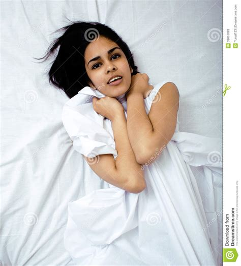 pretty blond woman laying in bed stock photos image