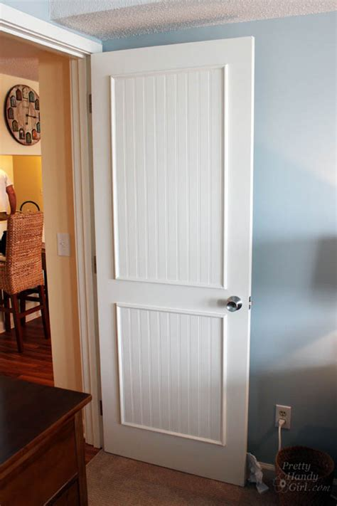 Adding Trim To Cabinet Doors How To Add Molding Panels To A Flat Door Pretty Handy