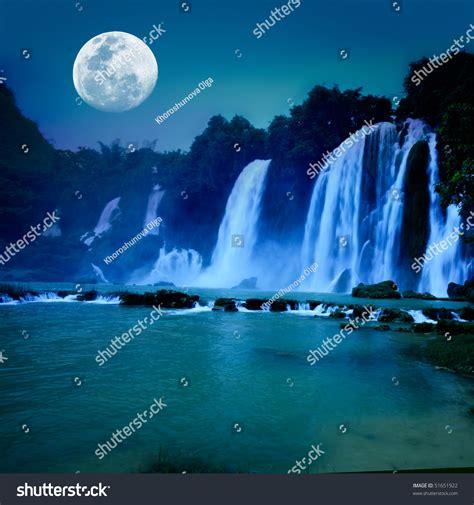 beautiful waterfall  moonlight night time stock photo