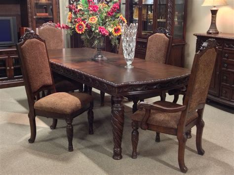 north shore  piece dining room set  ashley furniture  tricities  world dining