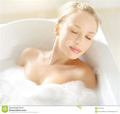girl in a bathtub attractive girl relaxing in bath royalty free stock photo