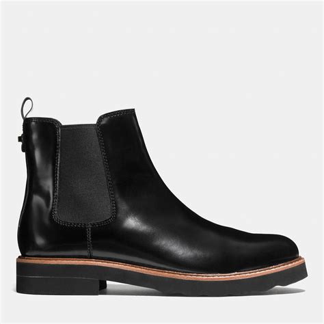 black boots lyst coach elijah boot in black