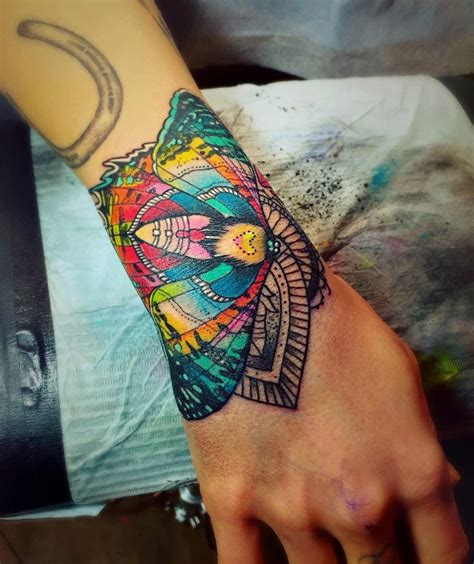 colored arm tattoo designs moth wrist best design ideas