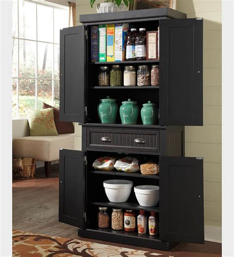 black kitchen storage cabinet nantucket kitchen storage pantry cabinet in a distressed