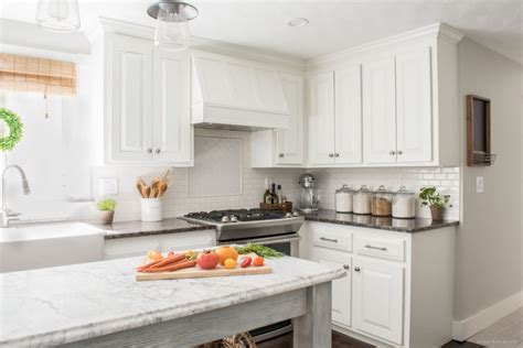 How We Painted Our Oak Cabinets And Hid The Grain How To Paint Oak Kitchen Cabinets White