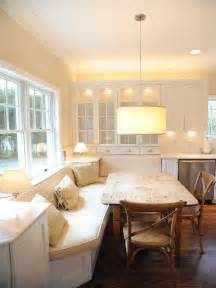 white banquette wood table kitchen space