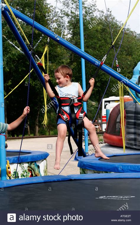 swing bungee young boy on bungee bounce swings at safety harness and