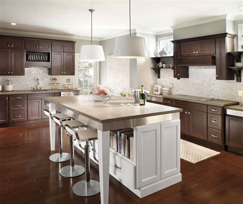 cherry cabinets with large white kitchen island