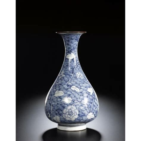 Yuan Vase by A Blue And White Peony And Wave Vase Yuan Dynasty