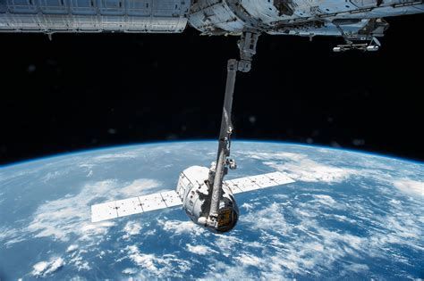 spaceport earth the reinvention of spaceflight books canadarm2 robotic arm grapples the spacex nasa