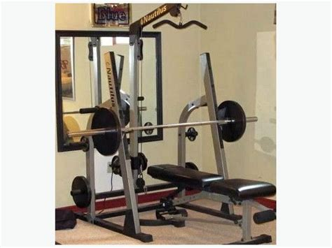 nautilus squat rack lat tower adjust bench 1inch weights