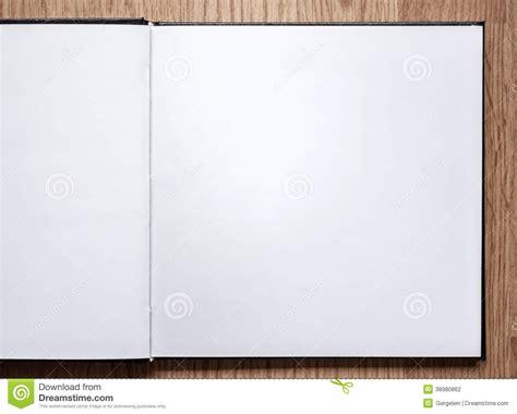 blank sketchbook blank notebook opened on wood background stock photo