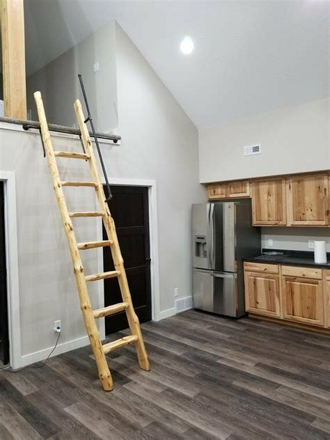 rustic pine library ladder loft  logcabinattic