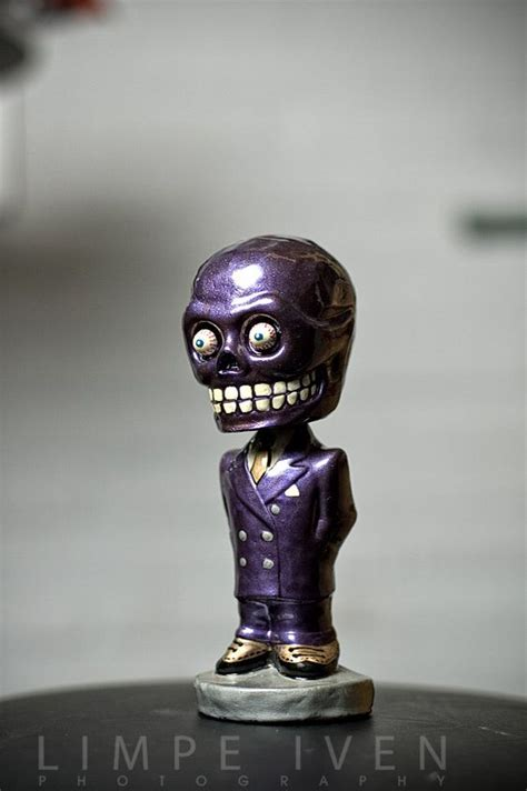 bobblehead on dash cars ornaments and purple on