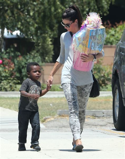 sandra bullock son sandra bullock takes louis to a birthday party in la