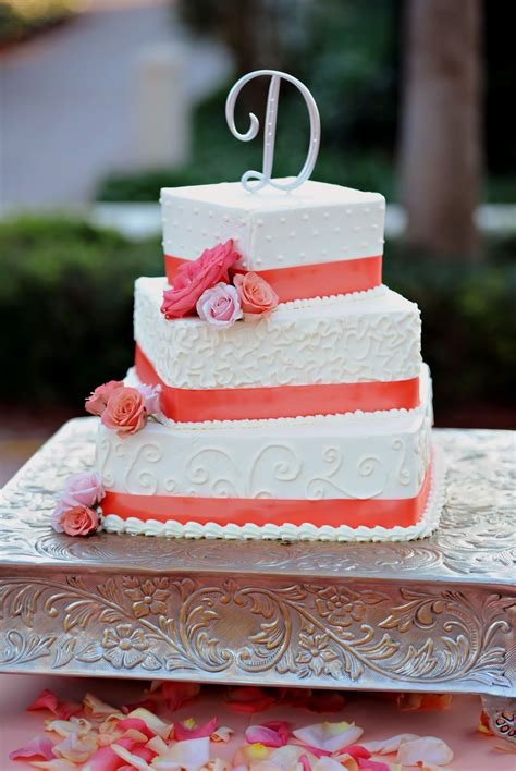 tiered square wedding cake  coral accents