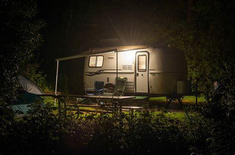 beleuchtung 12 volt caravan trailer glowing in forest c site