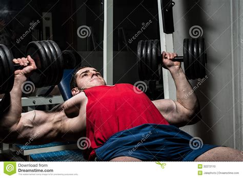 bodybuilder bench press young bodybuilder doing bench press for chest stock photo
