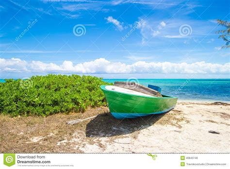 caribbean fishing boat plans old fishing boat on a tropical beach at the stock photo