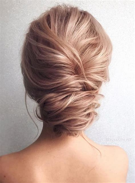 picture of a twist low updo with a look and texture for an yet effortless look