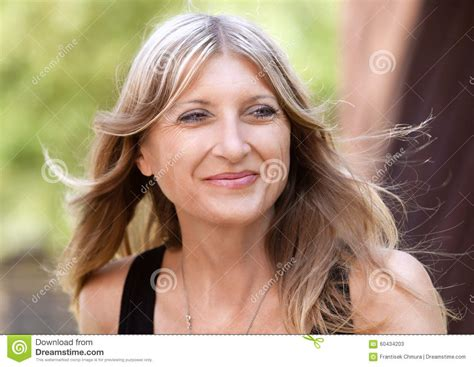 middle age blonde hair c portrait of a middle aged woman with blond hair stock