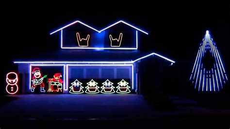 house with christmas lights set to music reindeer horns up this man s house has an animated christmas light show set to
