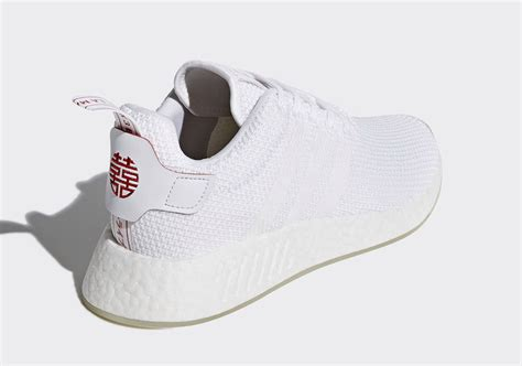 new year nmd tiger adidas presenta il suo new year pack