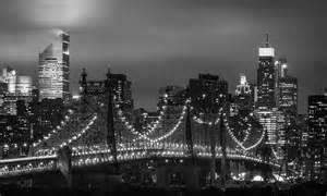city black light queensboro bridge lights black and white new york