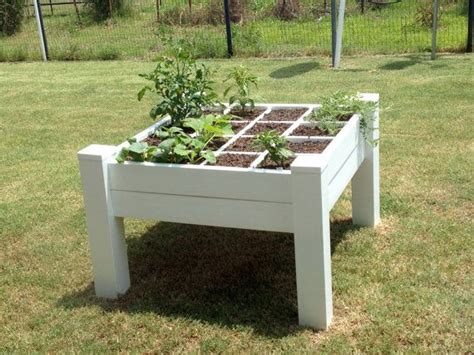 Raised Planters On Legs by A Raised Garden Bed With Legs Table Heighth By