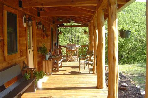 love this rustic cedar post porch cedar post