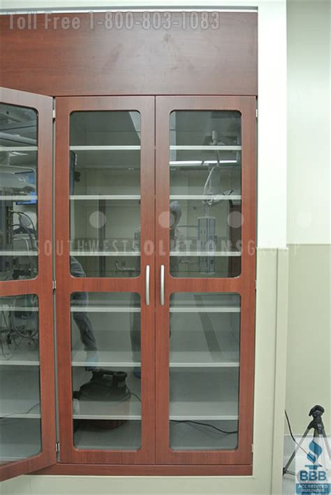 built in thermofoil glass door surgical cabinetry