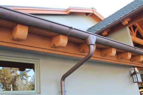 half round copper gutter w star outlet cast brass hanger