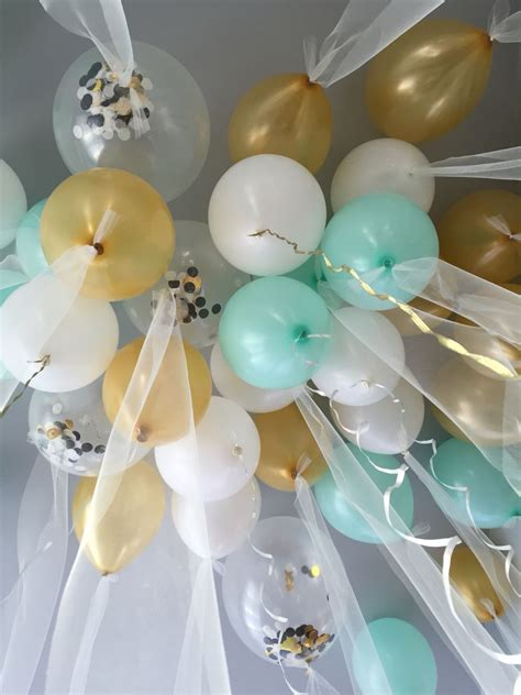 themes in black balloon tulle balloons for a gender neutral baby shower baby
