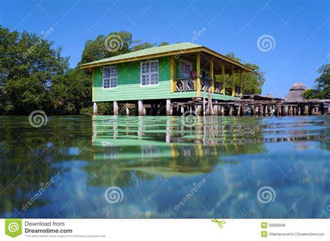 Raised Beach House Plans by Tropical Stilt House Over The Sea Stock Photo Image