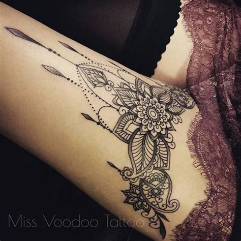 jewel tattoo on thigh by miss voodoo tattoo