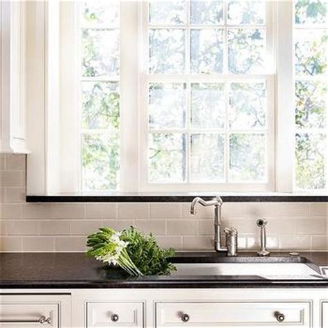 ivory subway tile backsplash ivory kitchen cabinets with black countertops