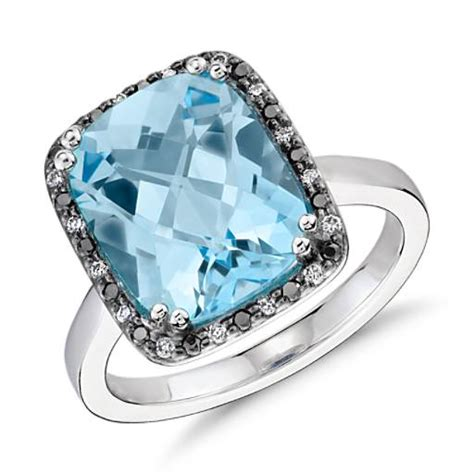 sky blue topaz and halo cushion cut ring in 14k