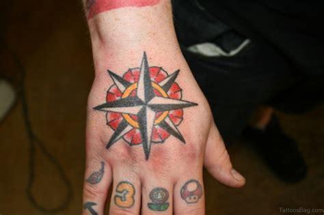 finger tattoo compass 63 super cool hand tattoos