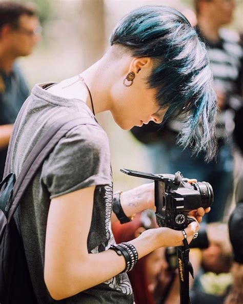 cute briaded hairstyles for a tomboy leather bracelet t shirt blue hair fashion style
