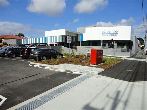 bid to buy accc opposes bid to buy brunswick hospital