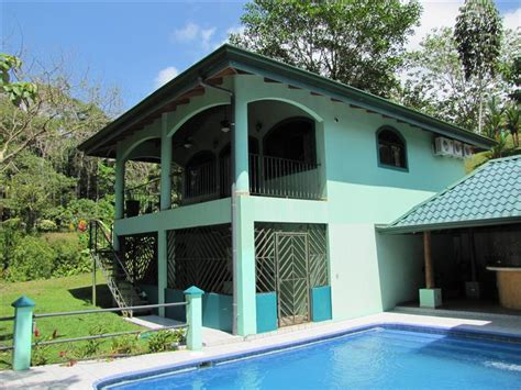 2 story house with pool two story villas sit at the bottom of this 5 acre property