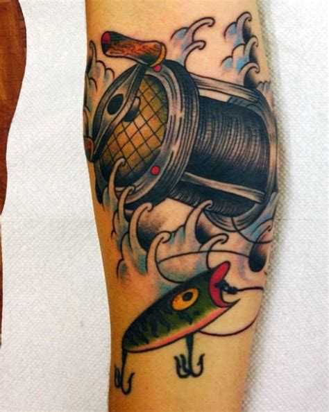 fishing pole tattoo looking colored fishing coil with lure
