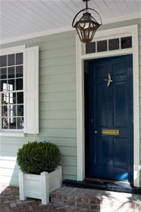 grey siding what color front door sherwin williams quot inkwell quot on the front door and quot hardware