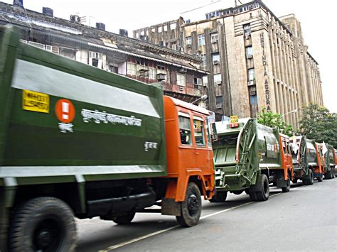 stock pictures garbage trucks  dumpers  india