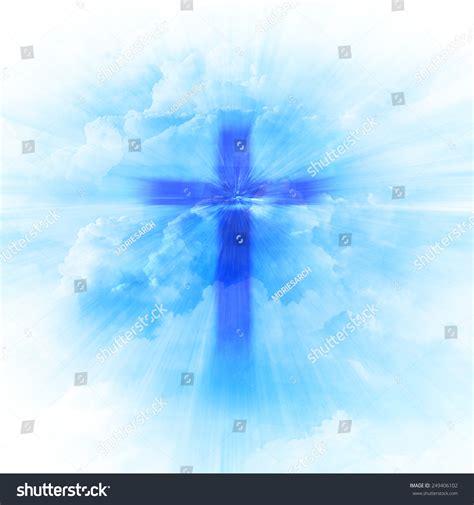 Blurry Christian Religious Cross On Blue Stock