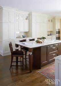 Small Kitchens With White Cabinets Brown Kitchen Island With White Marble Top Traditional