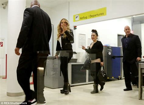 Carey At The Airport by Carey Shows Figure In Bodycon Trousers At